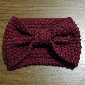 Knitted ear warmers with knotted front